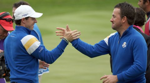 Europeans Rory McIlroy, left, and Graeme McDowell celebrate after each won their singles match Sunday at the Ryder Cup.