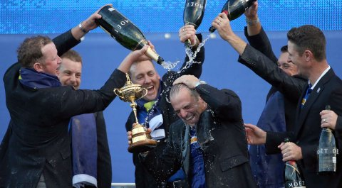 From left, European players Jamie Donaldson, Henrik Stenson, Ian Poulter, Lee Westwood and Justin Rose pour champagne over captain Paul McGinley as they celebrate winning the 2014 Ryder Cup.