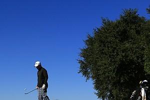 Mason Glinski kills some time while waiting at No. 2 during the Golfweek International Junior Invitational at ChampionsGate.