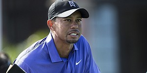 Woods battles bad health, chips in improved round