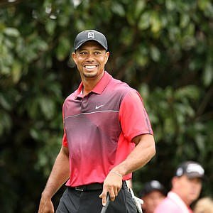 Tiger Woods flashes a smile on Sunday during the Hero World Challenge at Isleworth Country Club in Windermere, FL.