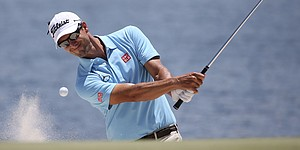 Scott moves into share of Australian PGA lead