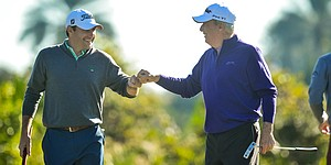 Teams Strange, Langer share Father/Son lead