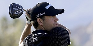 Kuchar's collapse sets up logjam at Humana