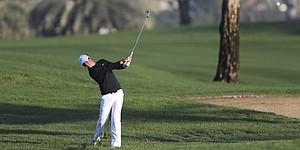 Rory McIlroy in Dubai hunt behind Bernd Wiesberger