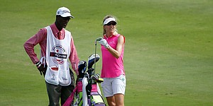 From ashes of despair, hope emerges for LPGA caddie 'Motion'