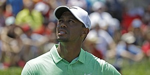 Tiger Woods struggles with double trouble at The Players