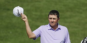 Quiet Dufner makes ace, cards 67 at Memorial