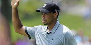 Tiger Woods provides Memorial drama with erratic play