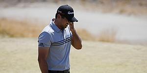 Jason Day digs deep, grabs share of U.S. Open lead
