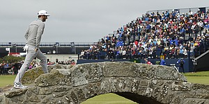 Recap: D. Johnson (65) takes British Open lead; Tiger cards 76