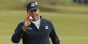 On an off-day at British Open, Kuchar bowls them over