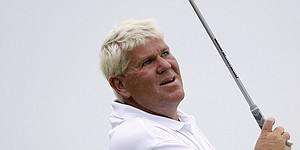 John Daly back to playing golf one day after collapsing on course