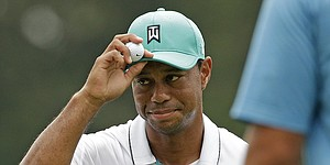 Tiger provides glimpse of past with 64 at Wyndham Championship