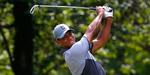 Recap: Tiger Woods cards 68, loses lead at Wyndham Championship