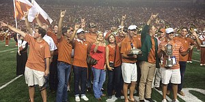 Jordan Spieth brings green jacket along to Texas football game