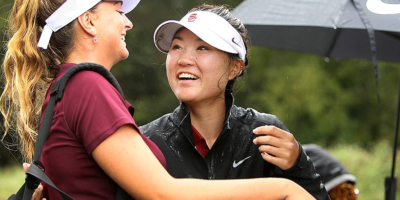 USC's Karen Chung celebrates after making eagle at the 18th hole to win the individual portion of the ANNIKA Intercollegiate at Reunion Resort.