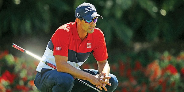 Adam Scott using a traditional-length putter at Presidents Cup