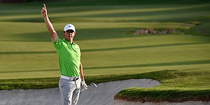 McIlroy two shots back in Dubai, tied with Race To Dubai challenger Willett