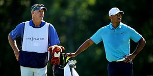 Tiger Woods' caddie isn't giving up on his boss