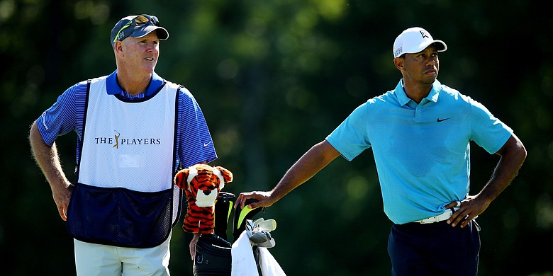 Joe LaCava and Tiger Woods, shown at the 2015 Players Championship