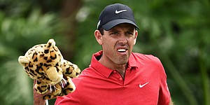 Schwartzel's 64 moves him within two shots of Michael at Thswane Open