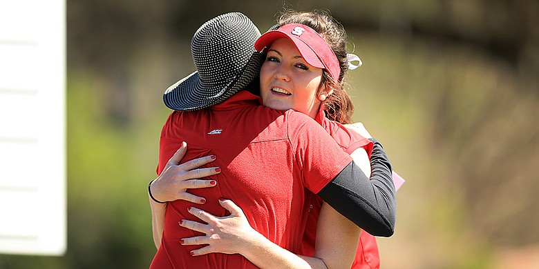 NC State's Rachael Taylor is hugged by her coach, Page Marsh after she won the SunTrust Gator Women's Invite at Mark Bostick Golf Course in Gainesville, Fla.
