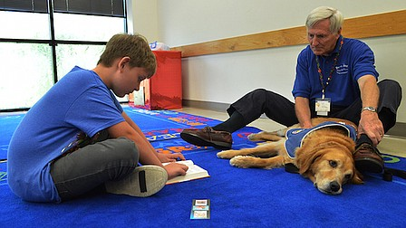 Book program encourages children to read with therapy dogs