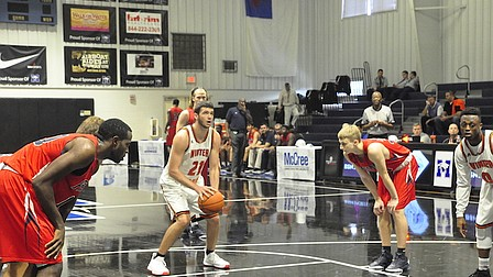 Wildcats fall, Eagles win it all in Tip-Off Classic