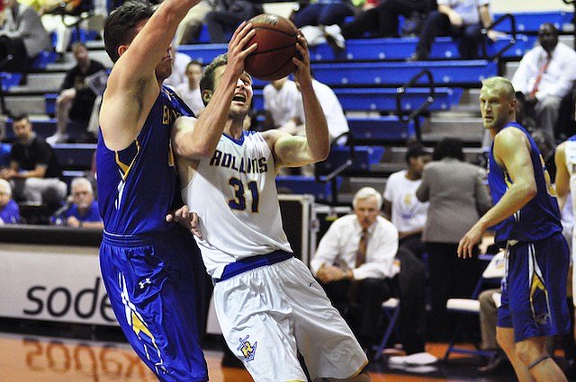 Rollins' Sam Philpott fights his way to the basket against Embry-Riddle on Feb. 1.