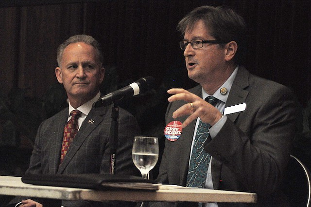 Commissioner Greg Seidel speaks during a candidate forum held last Wednesday.