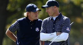 Jim Furyk yuks it up with partner Brandt Snedeker after their 1-up victory.